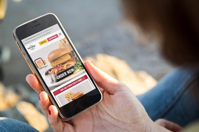Guest ordering Hard Rock Cafe Delivery from mobile device