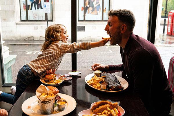 Dad enjoying Hard Rock Cafe with his daughter