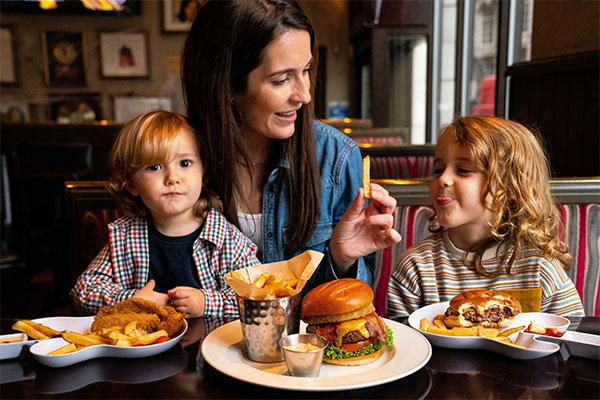 Mother enjoying Hard Rock Cafe with her children